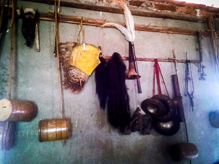 Musical instruments hanging on the walls of Natuoba's resident musician and instrument craftsman