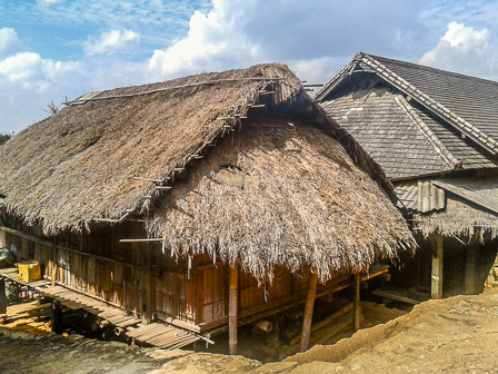 Traditional thatched roof home in Masan village