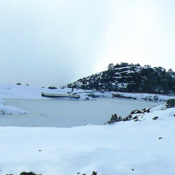 Heavenly Lake frozen solid on Jiaozi Snow Mountain