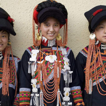 Yi minority women in traditional dress