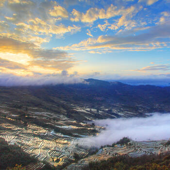 A spectacular sunset reflected by the rice terraces in Yuanyang, Yunnan