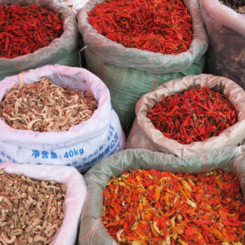 Spicy chilies, mushrooms and lichen for sale at a Yuanyang market (image credit: Chiara Ferraris)