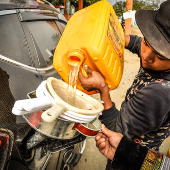 Buying roadside gas on the way to Putao, Myanmar