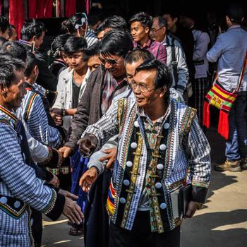 Burmese and Chinese Lisu meet at a church in Myitkyina, Myanmar