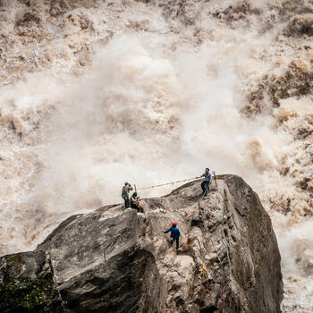 Time for a photo amidst the raging waters of the Yangtze River as it passes through Tiger Leaping Gorge (image credit: Yereth Jansen)