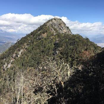 Summit of Wenbi Mountain in Lijiang, as seen from south peak