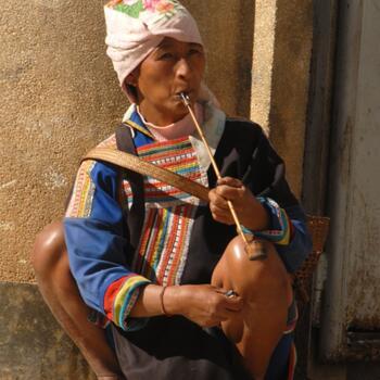 Lahu woman smoking a pipe in Lincang Prefecture, Yunnan