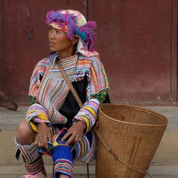 Lahu woman resting with a shopping basket in Lincang, Yunnan