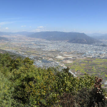 View from summit of Saddle Mountain. Left to right: Lashi Lake, north summit, Wenhai Mountain above north summit, Jade Dragon Snow Mountain, city of Lijiang, Wenbi Reservoir