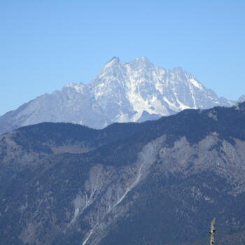 Telephoto lens shot of south face of Haba Snow Mountain, taken from summit ridge of Wenhai Mountain
