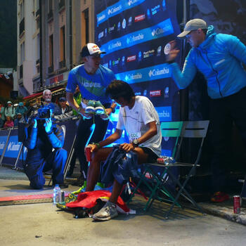 Exhausted Qi Min at the UTMB finish line. He came second but his language problems may have cost him the win (image credit: Pavel Toropov